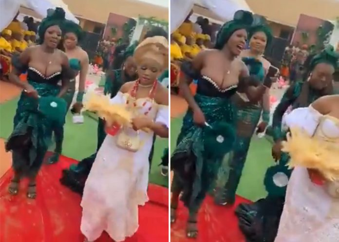 See How Bridesmaid Breast Caused Guest To Spray Money On Her Instead Of Bride